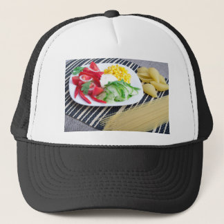 Closeup view of a vegetarian dish of raw vegetable trucker hat