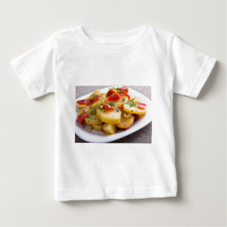 Closeup view of a vegetarian dish of stewed potato baby T-Shirt