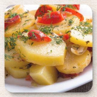 Closeup view of a vegetarian dish of stewed potato beverage coaster
