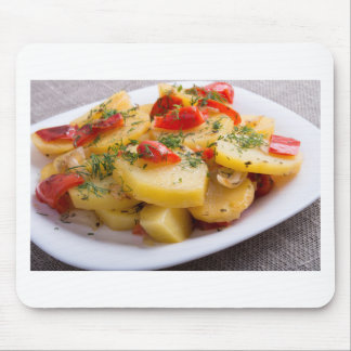 Closeup view of a vegetarian dish of stewed potato mouse pad
