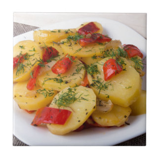 Closeup view of stewed potatoes small square tile