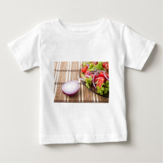 Closeup view on a fragment of a translucent plate baby T-Shirt
