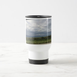 Clouds and field travel mug