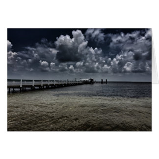 Clouds over a pier card