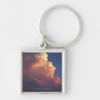Clouds over sea at sunset key chain