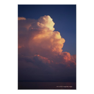 Clouds over sea at sunset poster