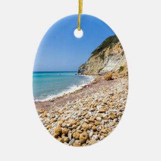 Coast landscape with stony beach and blue sea ceramic ornament