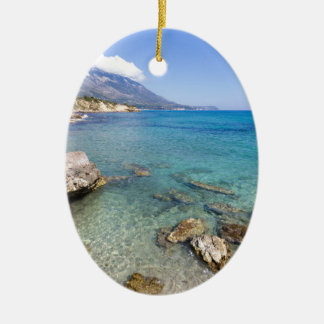 Coast with blue sea rocks and mountains in Greece Ceramic Oval Decoration