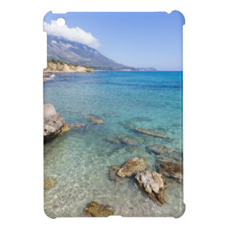 Coast with blue sea rocks and mountains in Greece iPad Mini Cases