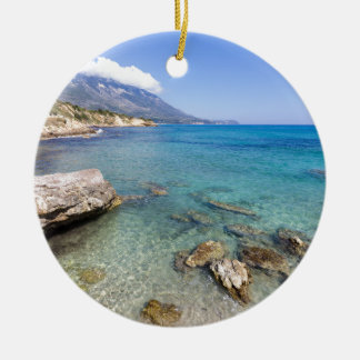 Coast with blue sea rocks and mountains in Greece Round Ceramic Decoration