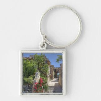 Cobblestone streets, historic stone buildings. Silver-Colored square key ring