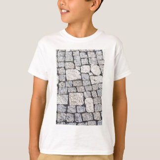 Cobblestones of a street in detail tee shirt