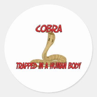 Cobra trapped in a human body round sticker