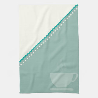 Coffee cup on two tone color kitchen towel