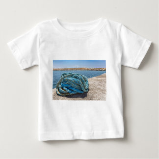 Coiled blue mooring rope at water in greek cave baby T-Shirt