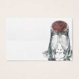 Coin splash in water on a white background business card
