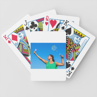 Colombian woman serve with badminton racket bicycle playing cards