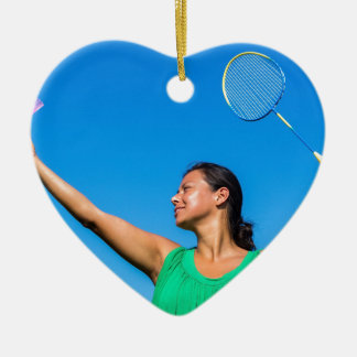 Colombian woman serve with badminton racket ceramic heart decoration