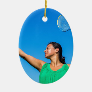 Colombian woman serve with badminton racket ceramic oval decoration