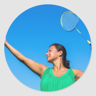 Colombian woman serve with badminton racket classic round sticker