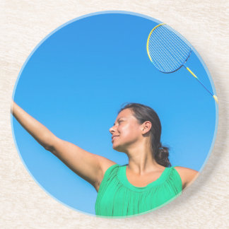Colombian woman serve with badminton racket coaster