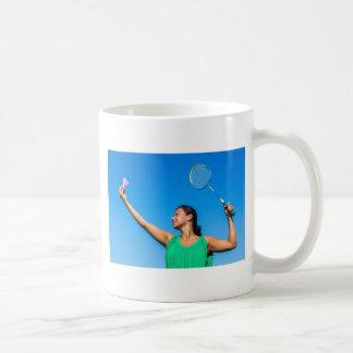 Colombian woman serve with badminton racket coffee mug