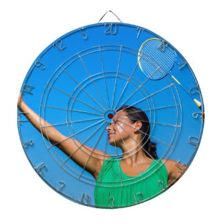Colombian woman serve with badminton racket dartboard