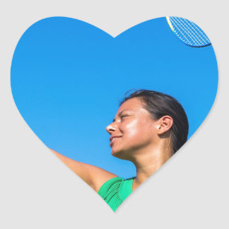 Colombian woman serve with badminton racket heart sticker