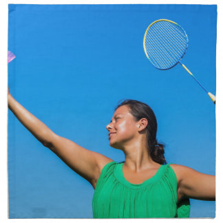 Colombian woman serve with badminton racket napkin