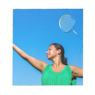 Colombian woman serve with badminton racket notepad