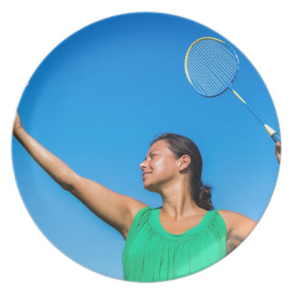 Colombian woman serve with badminton racket plate