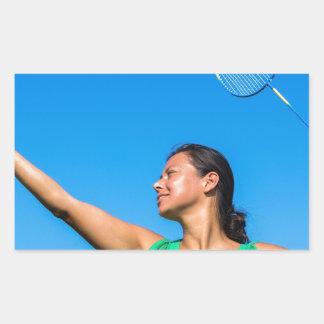 Colombian woman serve with badminton racket rectangular sticker