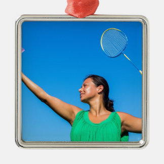 Colombian woman serve with badminton racket Silver-Colored square decoration