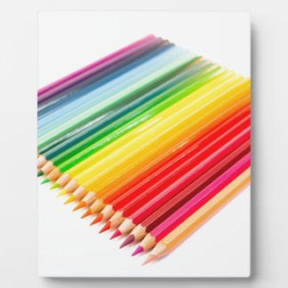 Colored crayons lying side by side photo plaque