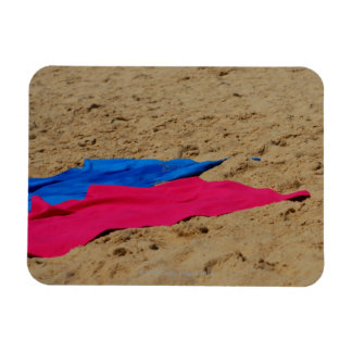 Colored towels on sandy beach magnet