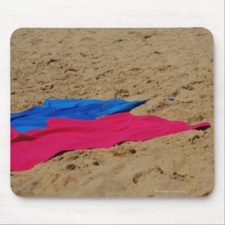 Colored towels on sandy beach mouse pad