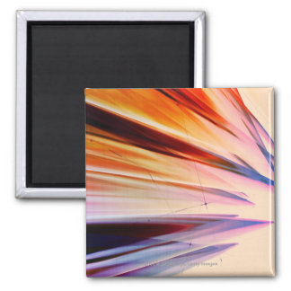 Colorful abstract objects against white square magnet