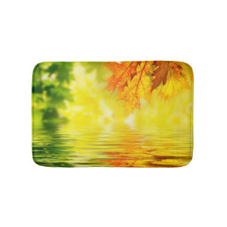 Colorful autumn leaves reflecting in the water bath mats