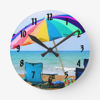 Colorful beach umbrella and chairs in Florida Round Clock