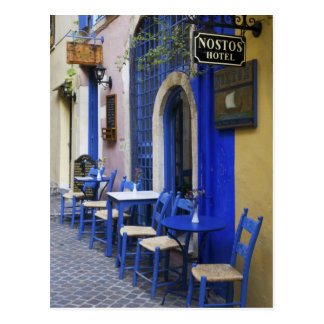 Colorful Blue doorway and siding to old hotel in Postcard