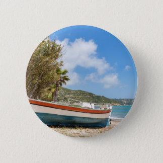 Colorful boat lying on greek beach 6 cm round badge