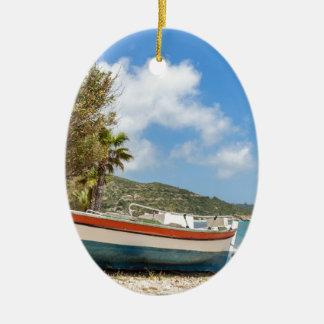 Colorful boat lying on greek beach ceramic ornament