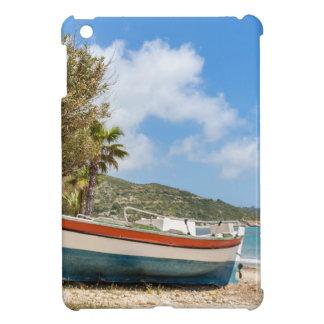 Colorful boat lying on greek beach iPad mini cover