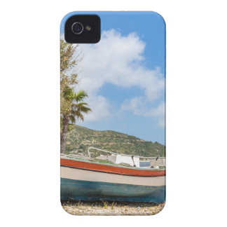Colorful boat lying on greek beach iPhone 4 cover