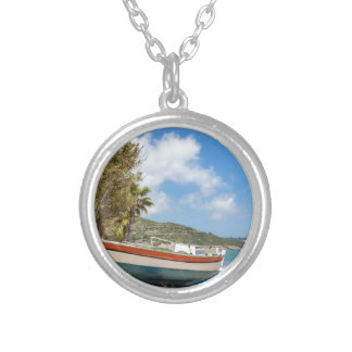 Colorful boat lying on greek beach silver plated necklace