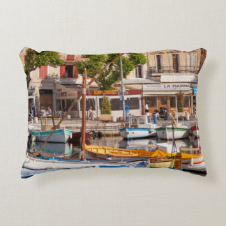 Colorful boats in the small harbor accent cushion