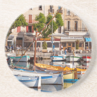 Colorful boats in the small harbor beverage coaster