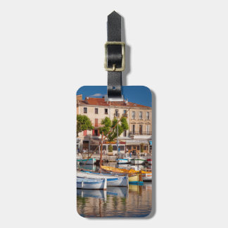 Colorful boats in the small harbor tags for bags