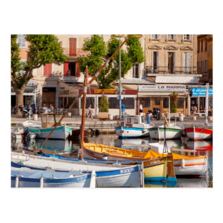 Colorful boats in the small harbor postcard