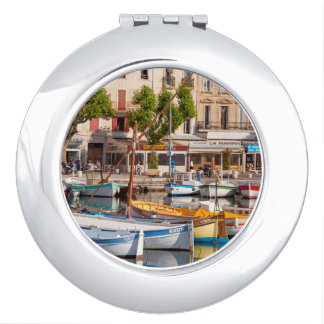 Colorful boats in the small harbor travel mirrors